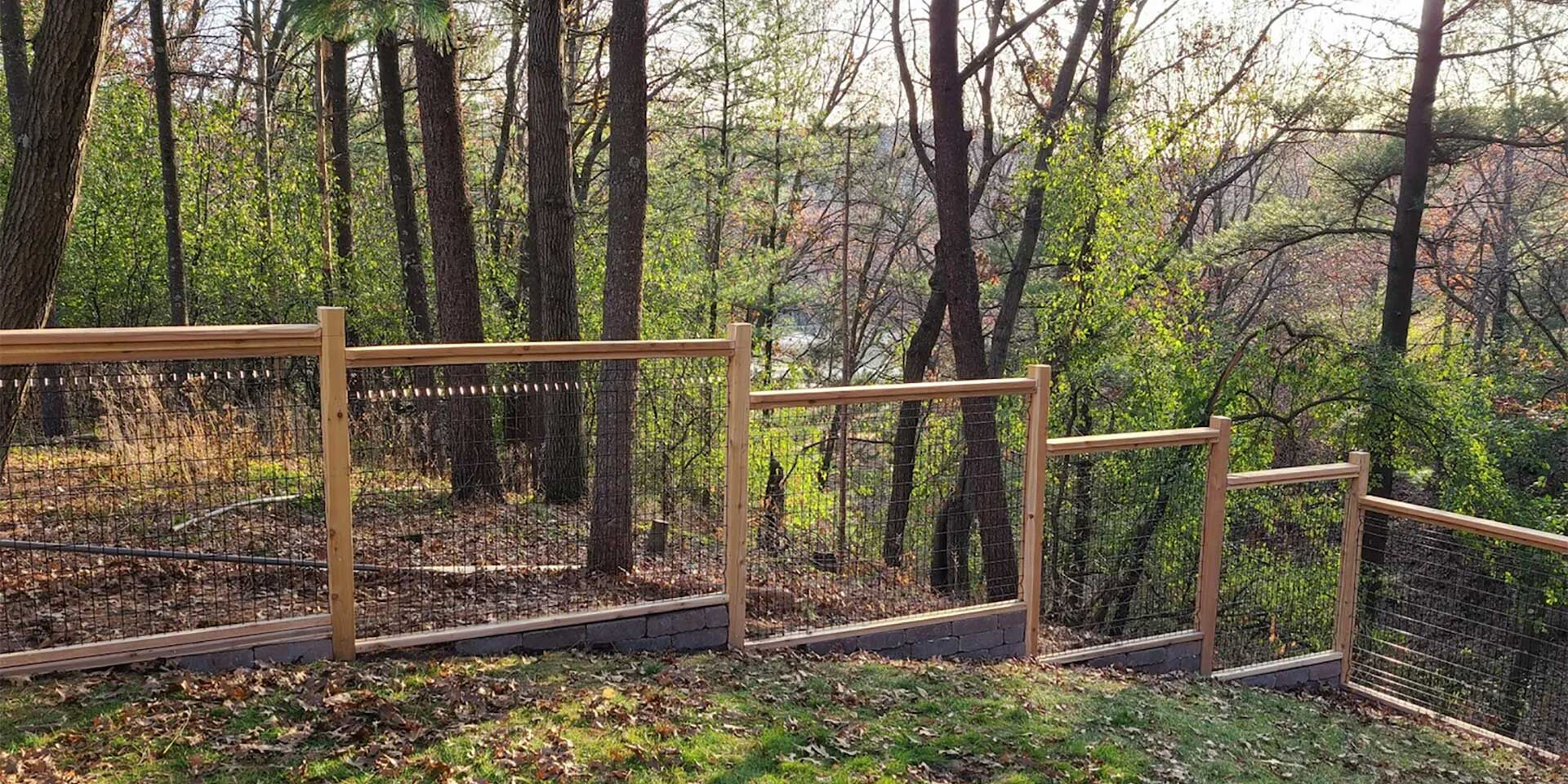 Photo of fence on a wooded hillside