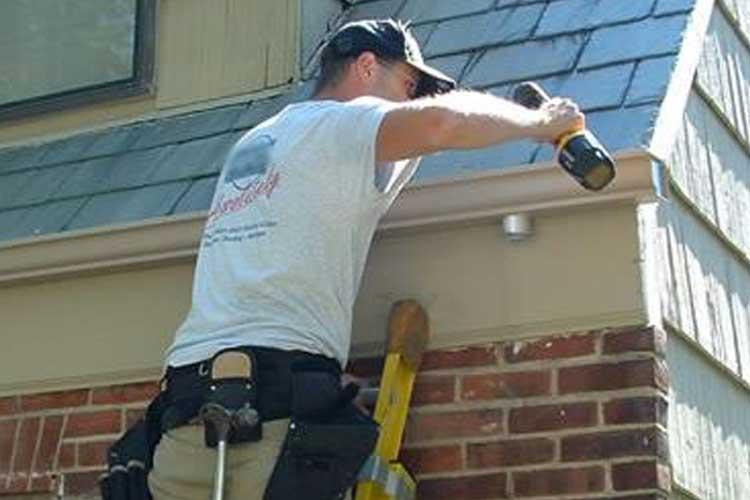 Photo of worker spraying foam insulation